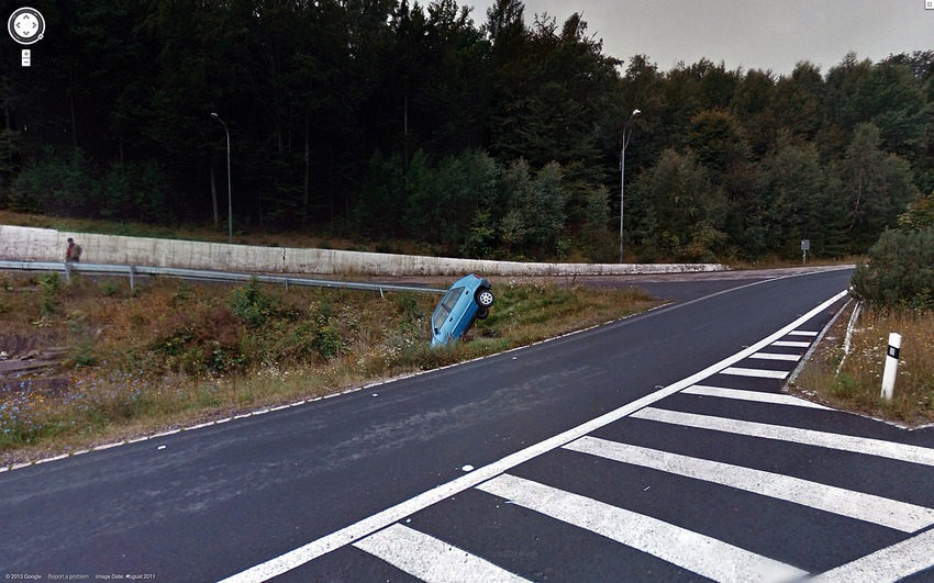 23. This Car Stuck in the Ground